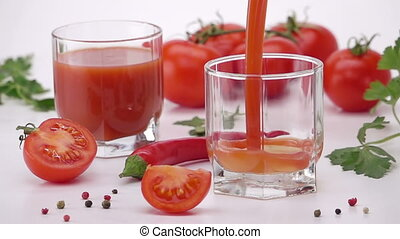 Pouring Tomato Juice Into Glass.