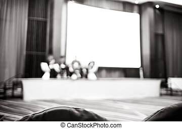 Black and white Blurred background : Speaker on stage in seminar convention hall