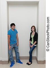 Two Teenagers - Two teenagers leaning in an alcove with...