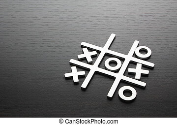 Tic Tac Toe on Wooden Background
