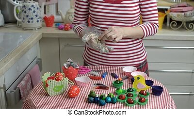 Painting Easter Eggs - Woman painting eggs for the Easter...