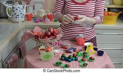 Decorating Easter Eggs - Woman decorating eggs for the...