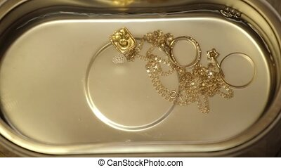 Cleaning of jewelry by ultrasound bath.