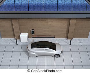 Silver car charging in home EV charging station. Power...