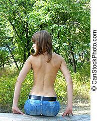 seminude girl in wood - seminude sexual girl sits on a log...