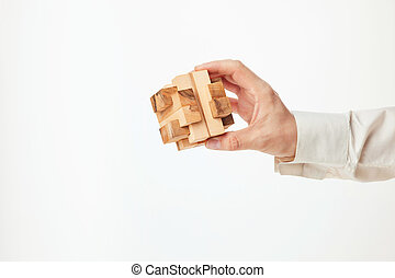 Man's hands holding wooden puzzle. The concept of business...