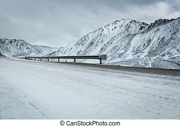 snow covered road - empty road with snow covered landscape...