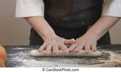 Making meat dumpling with wooden rolling pin. - Two woman's...