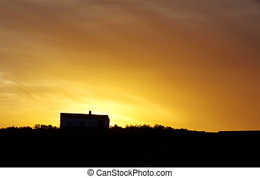 house in Alentejo region at sunset. Portugal