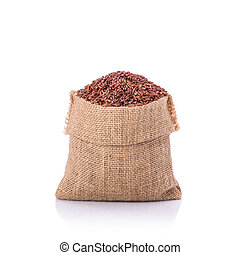 Thai red jasmine rice in small sack. Studio shot isolated on...