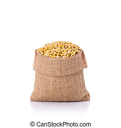Peeled soybean in small sack. Studio shot isolated on white...