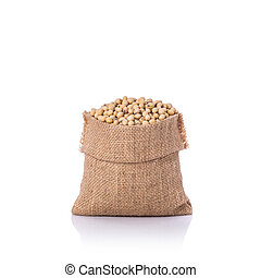 Soybean in small sack. Studio shot isolated on white...