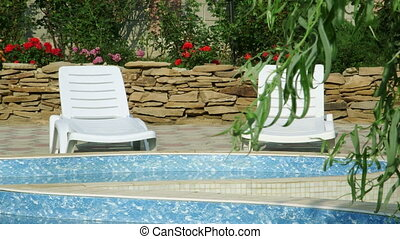 Back garden of a house with private swimming pool and patio...