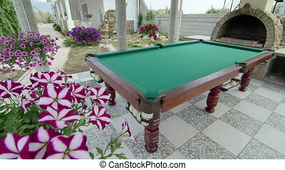 Outdoor billiard table area at back garden of a house