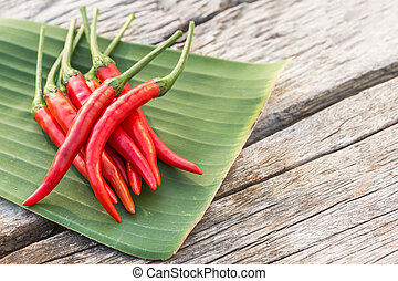 Fresh red hot chilli on wooden table background - Close up...