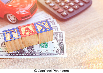 TAX write in color alphabet wood box on US dollar and red...
