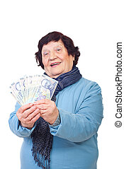 Cheerful elderly holding money