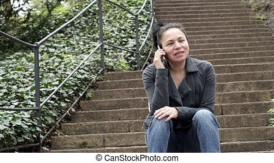 Woman in Mobile Phone Call on Outdoor Stairs Person Walks Up...