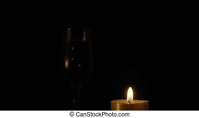 Candle burns on a black background. Slow motion