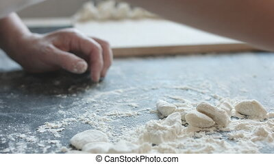 Two hands making dough for meat dumplings. - Side view of...