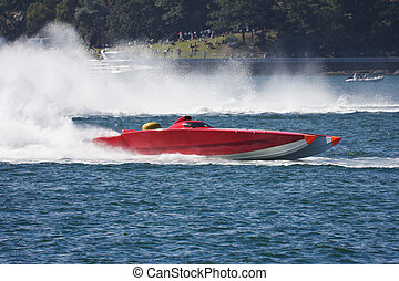 Powerboat racing across the water