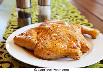 Uncooked whole chicken on a white plate - Uncooked whole...