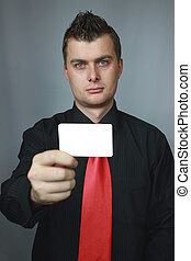 man with cut-away - young man holds cut-away in the right...