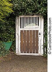 Hidden door in a bush