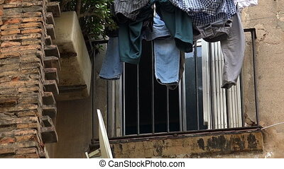 Linen drying on the balcony in Barcelona. Spain. - Linen...