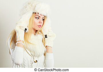 Blonde woman with fur cap. - Winter clothing, people,...
