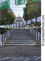 Steep steps to church on hill - Long concrete stairway leads...
