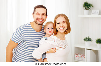 Happy family at home - Happy family mother, father, child...