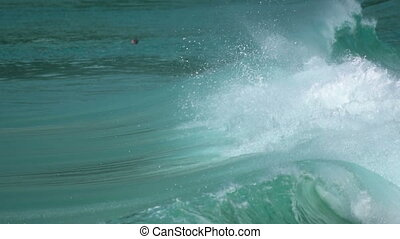 Big waves for surfers - Surfers in the ocean near Nai Harn...