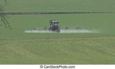 farmer spraying  in springtime