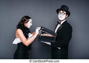 Pantomime actors comedy performing with case. Mime theater...