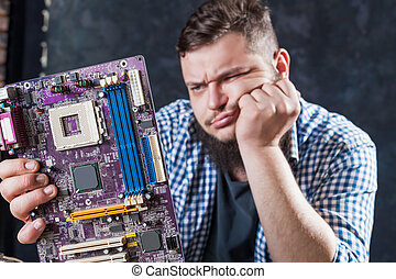 Service engineer fixing problem with motherboard - Service...
