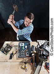 Service engineer with sledgehammer brakes laptop and...