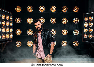 Bearded singer on stage with decorations of lights - Bearded...
