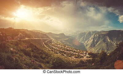 Dramatic aerial mountain village view. Colorful cloudy...