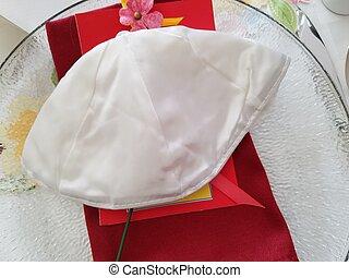 Jewish Yarmulke - Traditional yarmulke at place setting at...