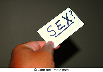 Sex? - Businessman passes his card under the dinner table to...