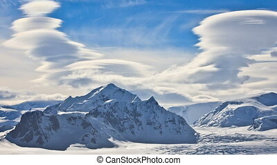 Antarctic Nature: snow-capped mountains against dramatic sky...
