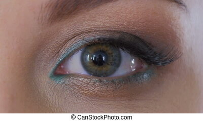 Close up shot of woman opening her eyes