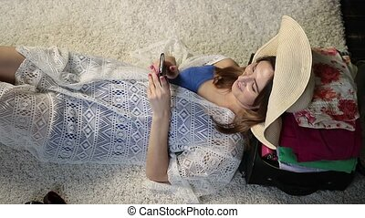Relaxed young woman typing message on smartphone - Top view...