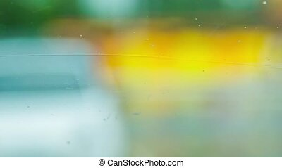 Brushes wipe the water from the windshield of the machine during rain.
