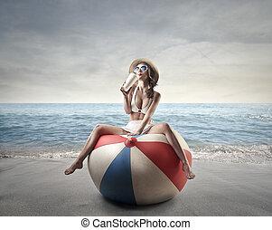 Woman on beach on beach ball