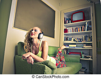 Woman listening to music - Blonde woman listening to music