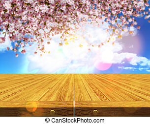 3D wooden table against a defocussed cherry tree blossom...