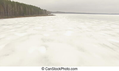 Aerial shot of frozen lake - Aerial shot moving over frozen...