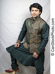 indian male model in artistic traditional kurta standing...